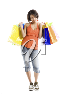 An isolated shot of a black woman with tired look carrying shopping bags