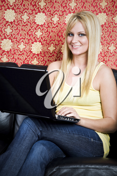 A beautiful caucasian college student working on her laptop