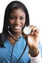 An isolated shot of an african american nurse holding a stethoscope (focus on the stethoscope)
