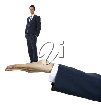 male hand palm up on white background holding businessman