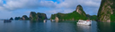 Cruise boats in Halong Bay, Vietnam, Southeast Asia. UNESCO World Heritage Site. Panorama.