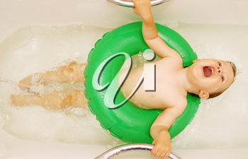 girl singing in the bath, a lying on the inflatable circle