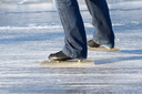 A ice skater is skating on the famous dutch Bonkevaart Friese Elfstedentocht