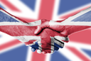 Man and woman shaking hands, wrapped in flag pattern, United Kingdom