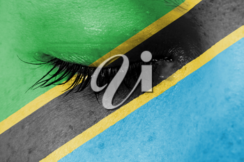 Crying woman, pain and grief concept, flag of Tanzania