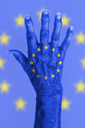 Isolated old hand with flag, European Union, EU