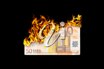 Burning money, euro bill on fire, isolated on black