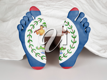 Feet with flag, sleeping or death concept, flag of Belize
