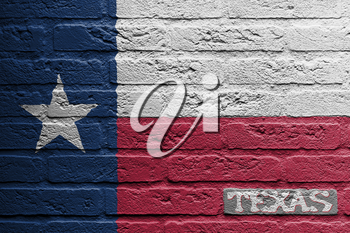 Brick wall with a painting of a flag isolated, Texas