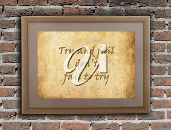 Old wooden frame with written text on an old wall - Try and fail, don't fail to try