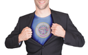 Businessman opening suit to reveal shirt with state flag (USA), Minnesota