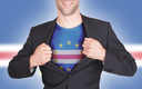 Businessman opening suit to reveal shirt with flag, Cape Verde