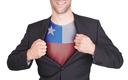 Businessman opening suit to reveal shirt with flag, Chile