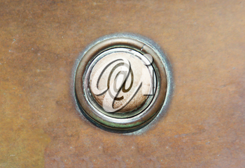 Grunge image of an old button - @
