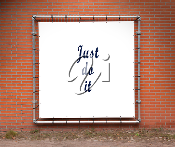 Large banner with inspirational quote on a brick wall - Just do it