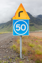 Curve with advisory speed limit in Iceland