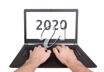 Modern laptop isolated on a white background - New Year - 2020