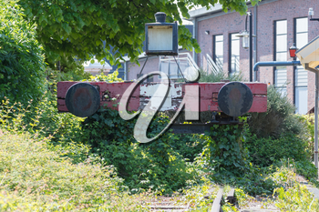 Decaying railroad bumper stop on an old dutch train