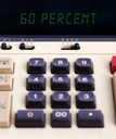 Old calculator with digital display showing a percentage - 60 percent