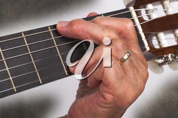 Old hand and guitar isolated on white background