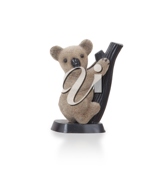 Koala figurine on a branch with white background