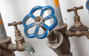 Old pipelines with blue valve, plumbing in the 80s
