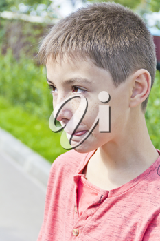 Vertical portrait of teenager boy with put out tongue