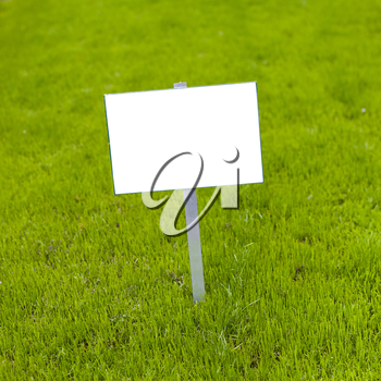 Sign on grass whith isolated space for caption