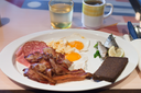 white plate with hotel full English breakfast