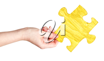 female hand with painted yellow puzzle piece isolated on white background