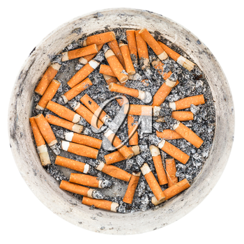 many cigarette ends in plastic ashtray isolated on white background