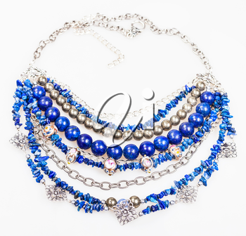 blue necklace from natural gemstones (lapis lazuli - lazurite, pyrite, glass lampwork beads) on white background