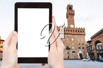 travel concept - tourist photographs Piazza signoria with Palazzo Vecchio in Florence city on tablet with cut out screen with blank place for advertising in Italy