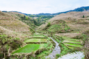 travel to China - view of terraced fields and creek in Dazhai village in country of Longsheng Rice Terraces (Dragon's Backbone terrace, Longji Rice Terraces) in spring