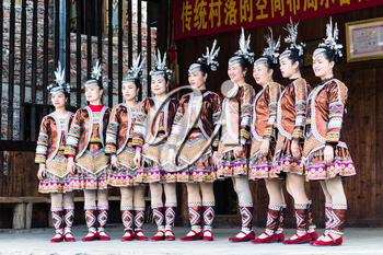 CHENGYANG, CHINA - MARCH 27, 2017: singers in Culture Show on square of Folk Custom Centre of Chengyang village of Sanjiang County in spring. Chengyang includes eight villages of the Dong people