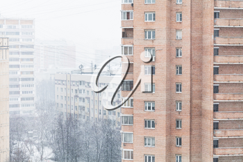 snowfall in residential district of Moscow city in cold wither day