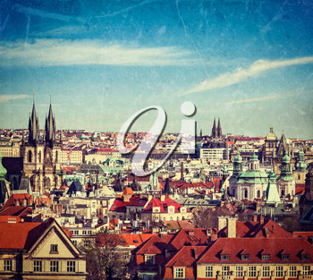 Vintage retro hipster style travel image of aerial view of Prague, Czech Republic with grunge texture overlaid