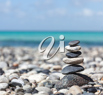 Zen meditation background -  balanced stones stack close up on sea beach