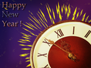 Clock face and yellow firework taken closeup on blue background.Eve of new year.