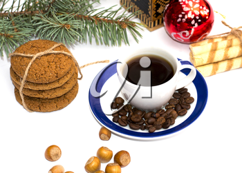 linking of cookies, fir-tree branch, cup of coffee, coffee grains and nutlets, isolate, subject hot drinks and sweets, holidays Christmas and New Year
