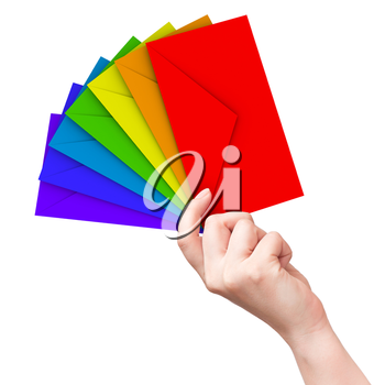 Colorful envelopes in the female hand isolated on white background