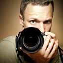 Young photographer with camera