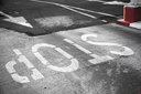 Road marking with grungy stop label on urban asphalt pavement