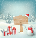 Winter Christmas Background with Wooden Signpost Snowman and Gift Boxes