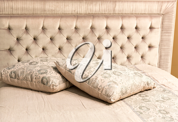 Luxury bed with pillows closeup