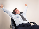 Office worker in a suit celebrates victory