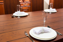 Elegean servered wooden table with plates
