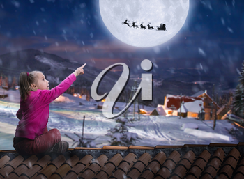 Girl sits on the roof in winter night