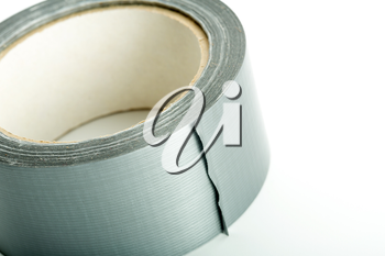 Roll of silver adhesive tape on white background