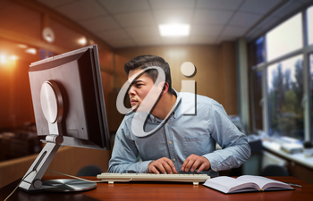 Young businessman working hard in the office with computer